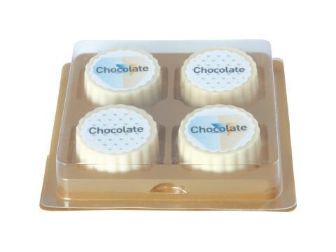 4 logo bonbons, white chocolate with hazelnut praline